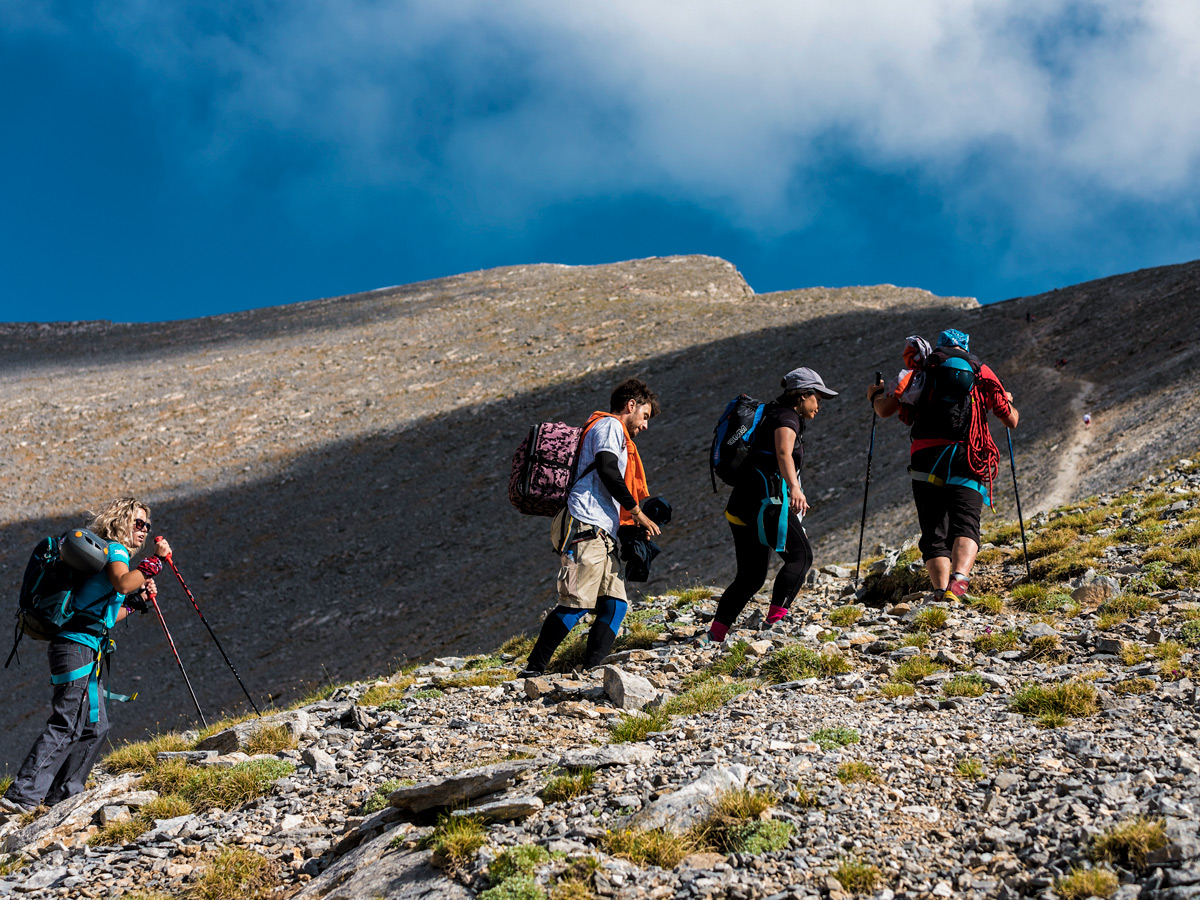 Hikers ascending to the top of Mount Olympus on guided climb to Mount Olympus, Greece