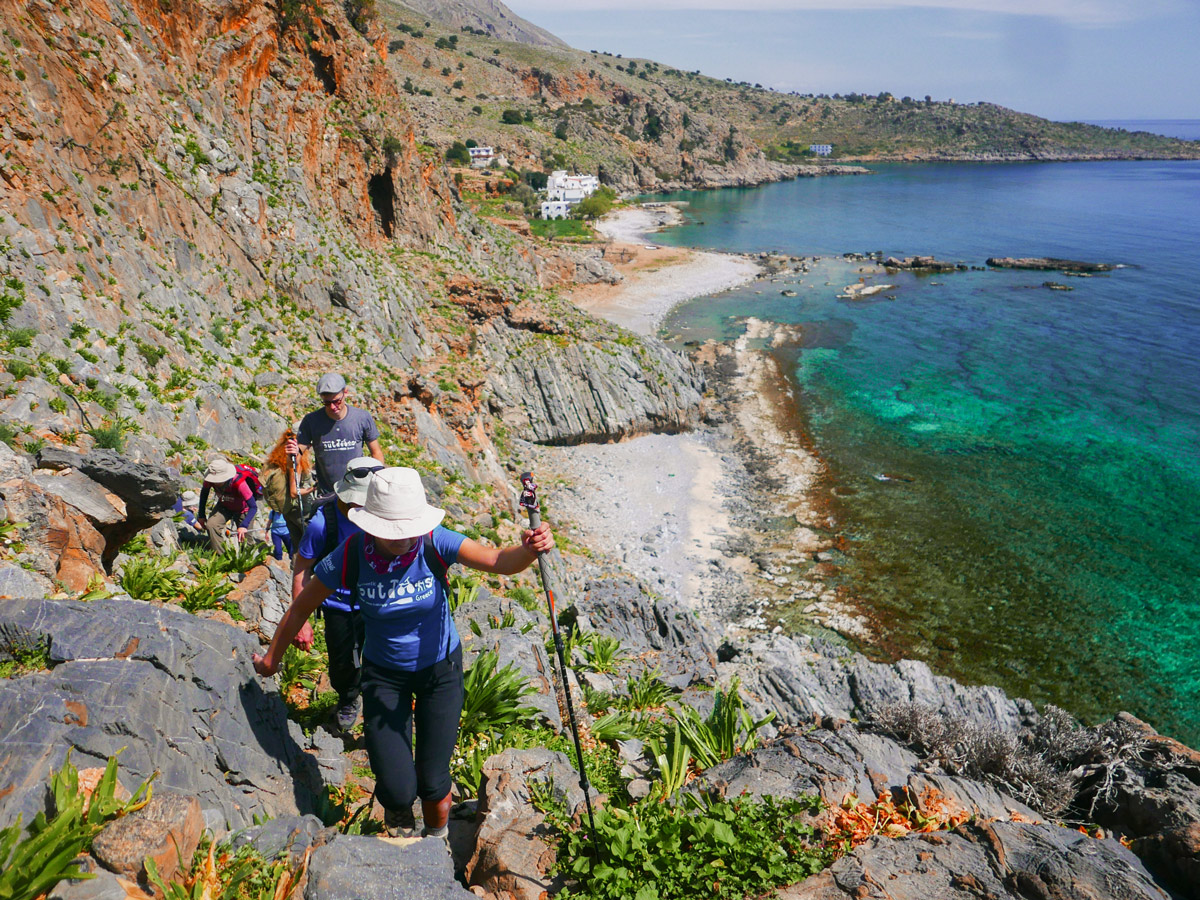 Hiking along the coast of Crete on guided trek in the White Mountains of Crete, Greece