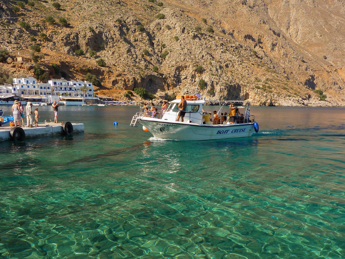 Water taxi on guided trek in the White Mountains of Crete, Greece