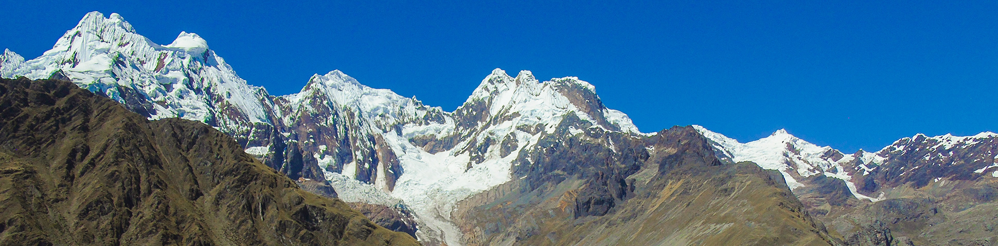 Panoramic view of white peaks along Alpamayo trek in Cordillera Blanca, Peru