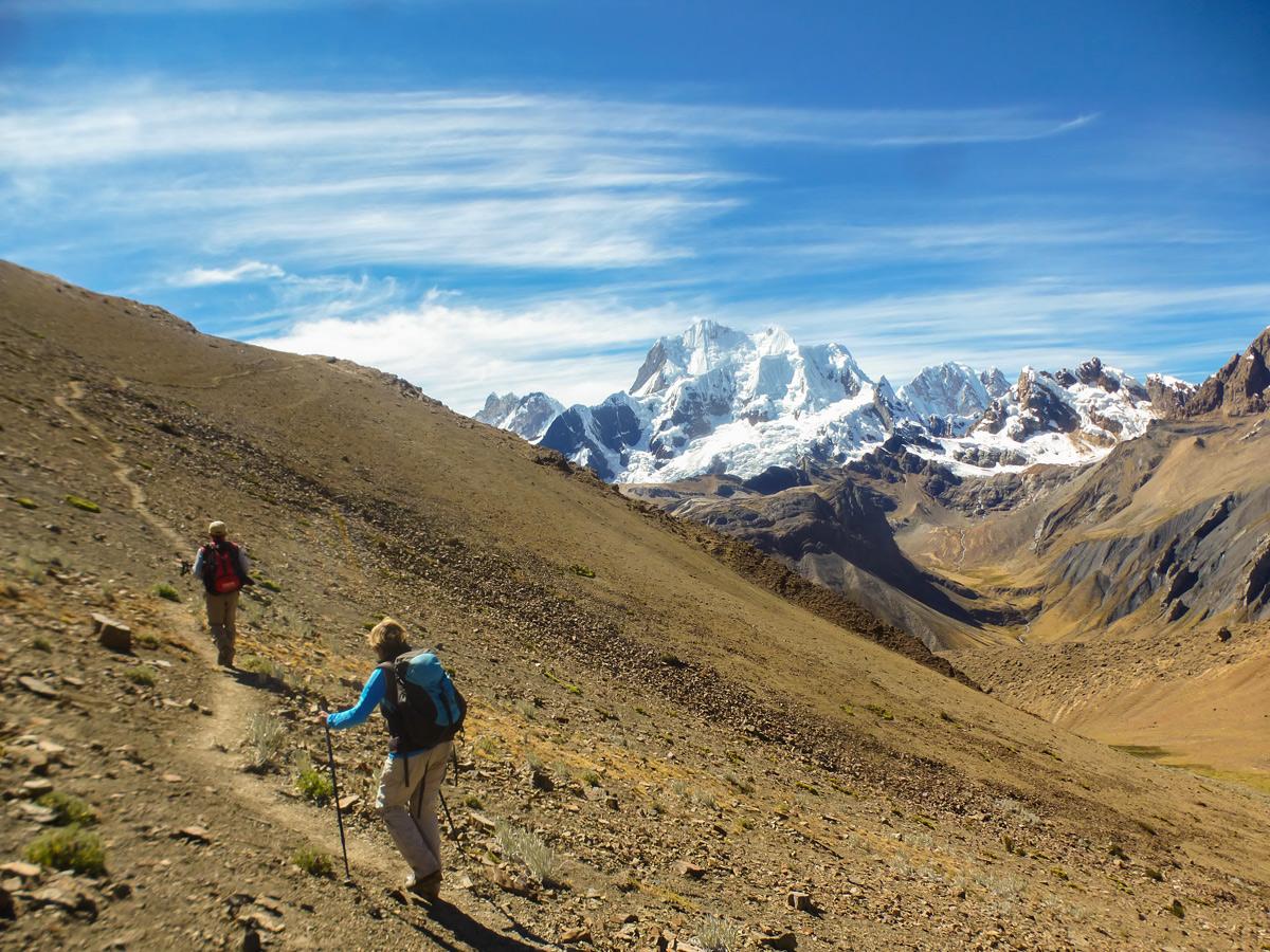 Two hikers and beautiful mountain view on standart Huayhuash circuit trek, Peru