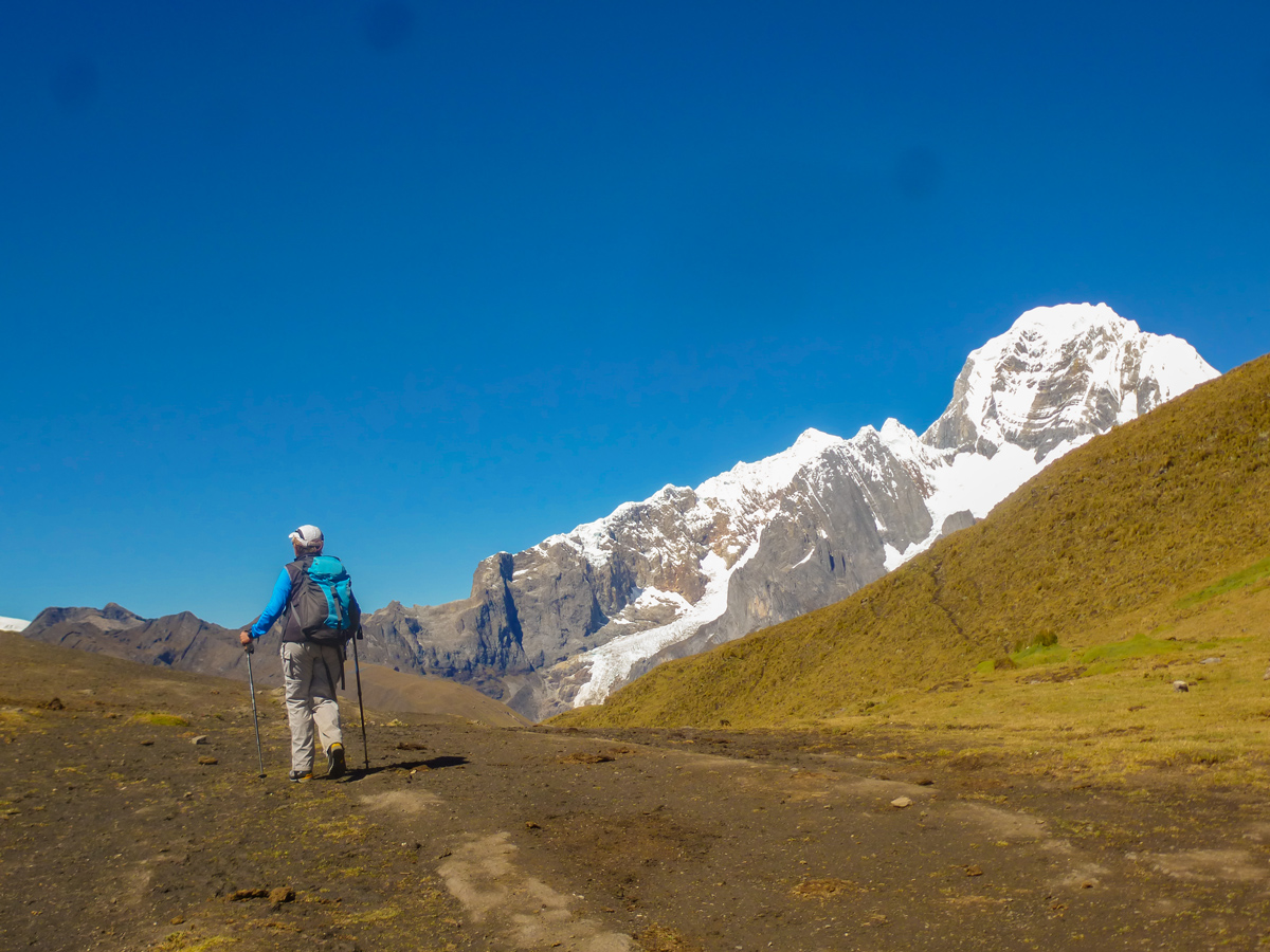 Summiting a pass on Cordillera Huayhuash trek in Peruvian Andes