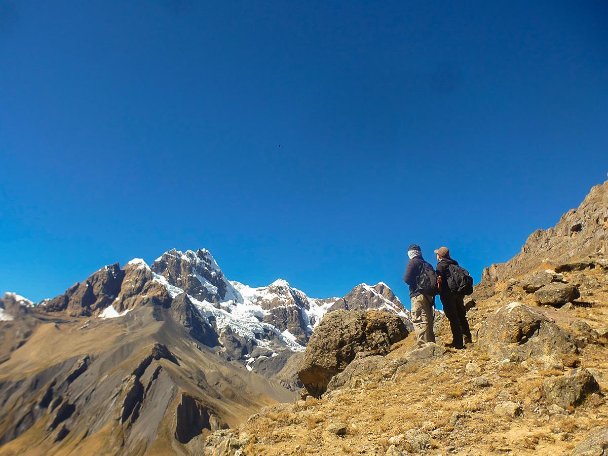 Couple of hikers on standart Huayhuash circuit trek, Peru