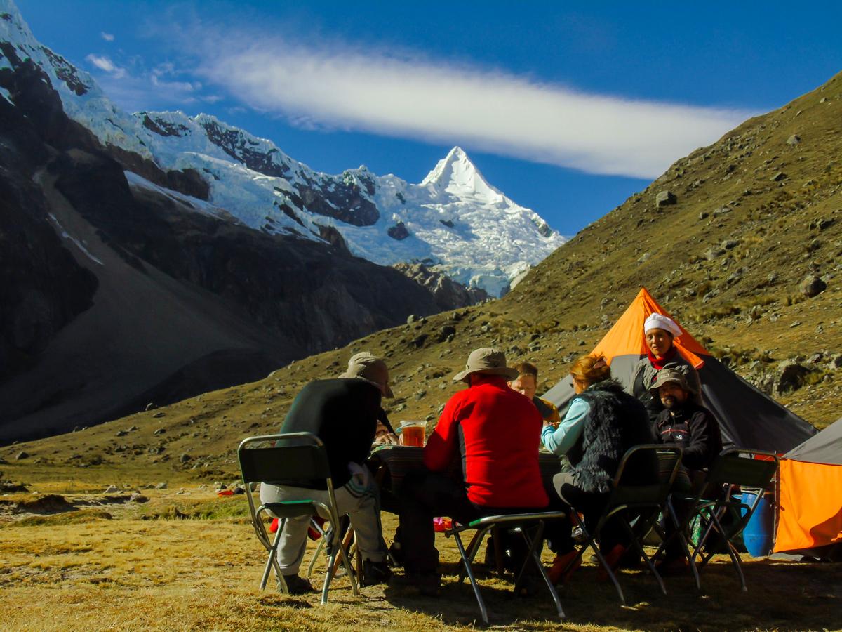 Having lunch with beautiful view on Alpamayo trek in Cordillera Blanca, Peru