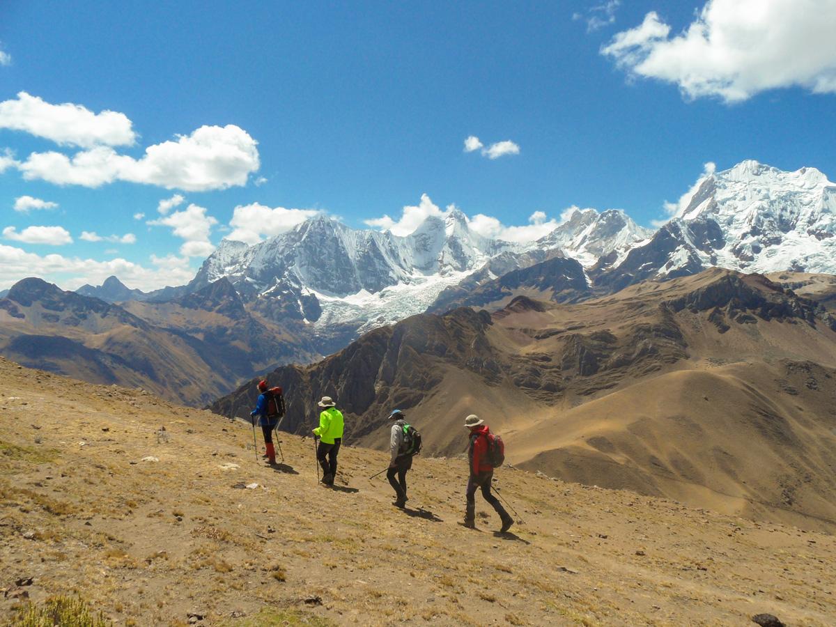 Four hikers trekking on Huayhuash circuit trek, Peru