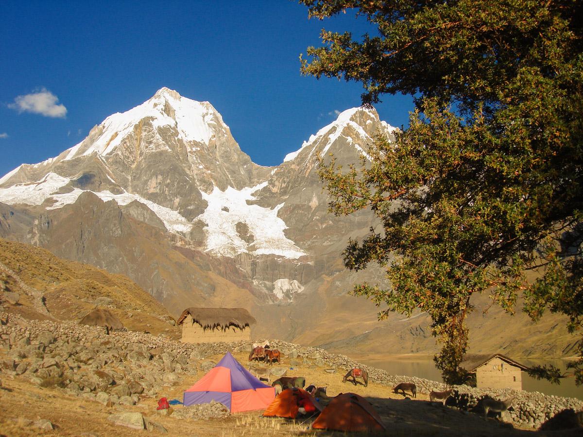 Tents, horses and mountains on Huayhuash circuit trek, Peru