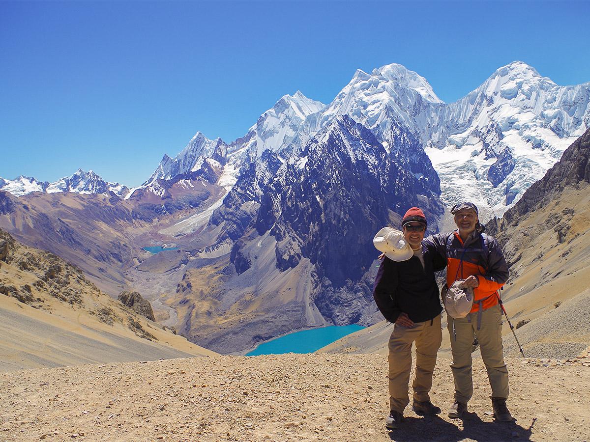 Hiker with a guide on Huayhuash circuit trek, Peru