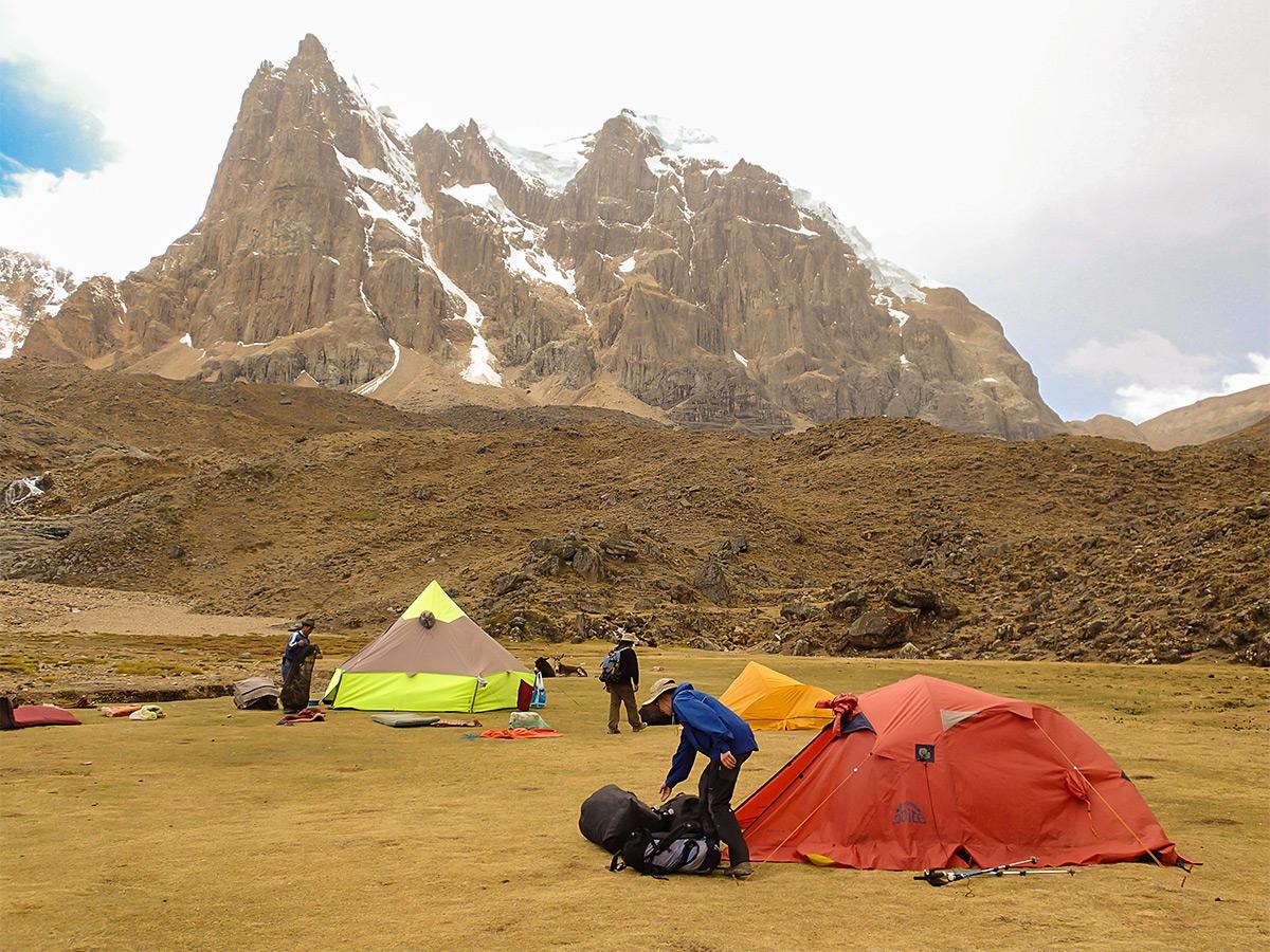 Hikers and the campsite on Huayhuash circuit trek, Peru