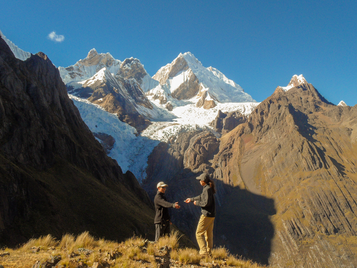 Giving a tip for a guide on Cordillera Huayhuash trek, Peru