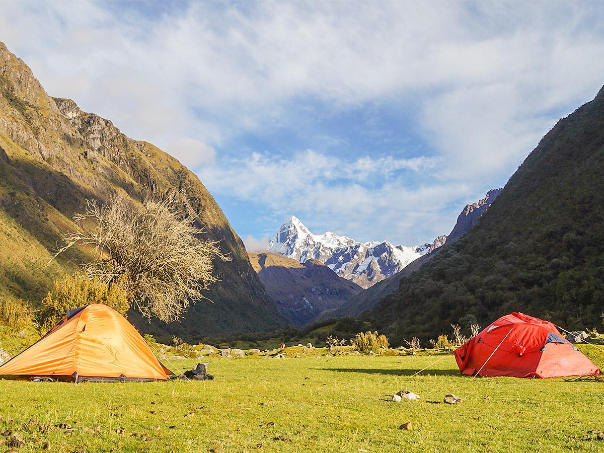 Campsites with beautiful view of Peruvian Andes on Santa Cruz trek
