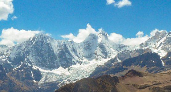 Panoramic view of white Andean mountains on Huayhuash circuit trek, Peru