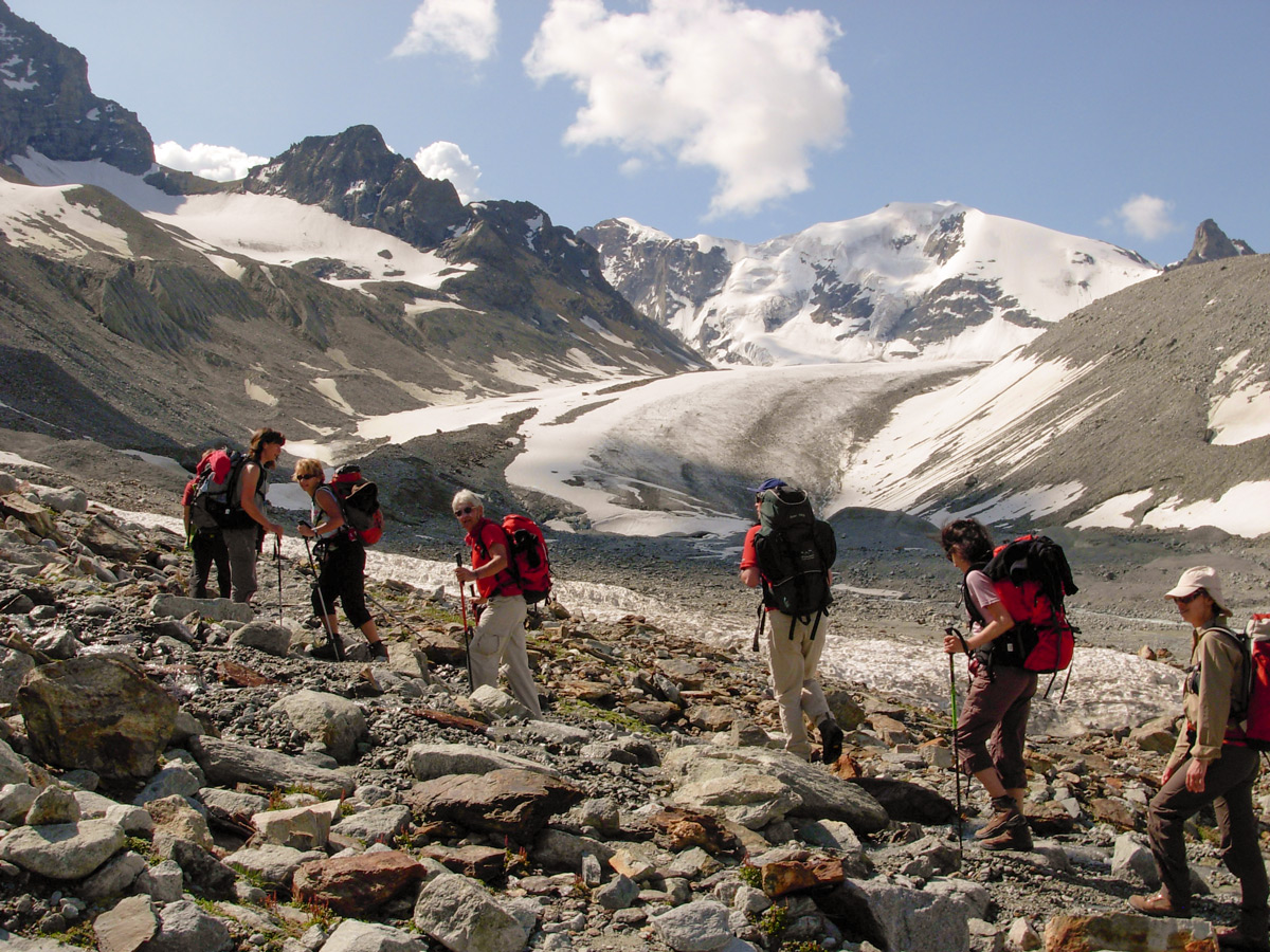 Hikers near glacier on self-guided Haute Route from Chamonix to Zermatt