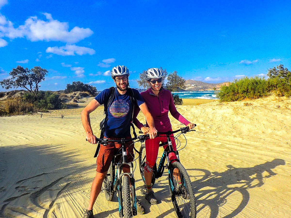 Two happy cyclists riding along the Greek coast on Greek Islands Multisport tour in Paros, Naxos and Santorini
