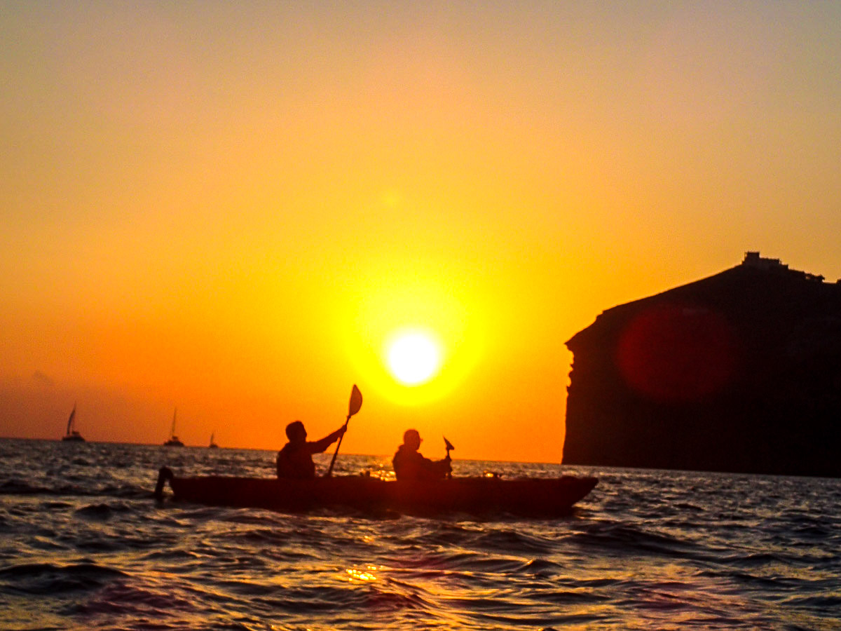 Two kayakers and sunset on Greek Islands Multisport tour in Paros, Naxos and Santorini