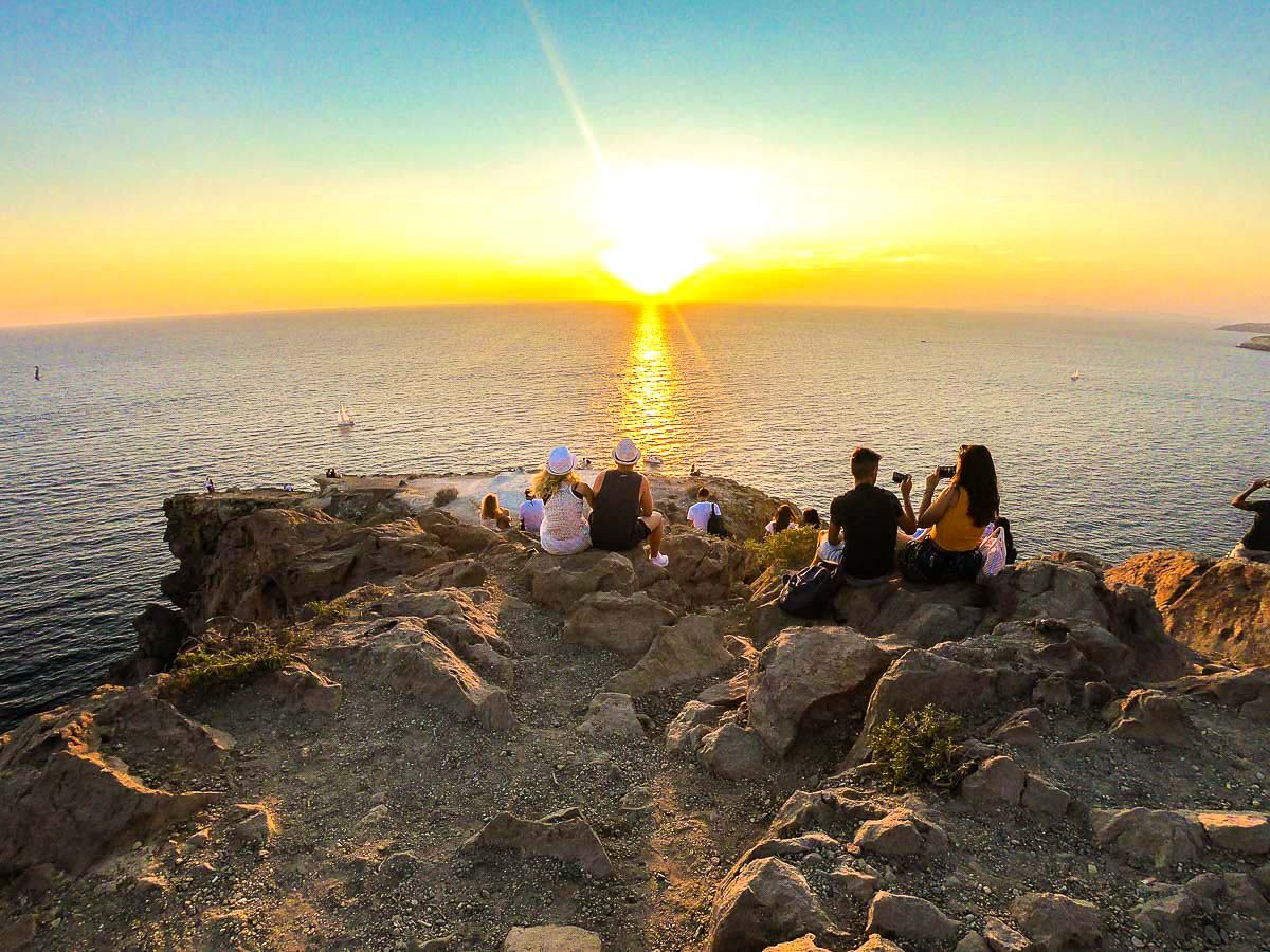 Group of hikers and beautiful sunset on Greek Islands Multisport tour in Paros, Naxos and Santorini