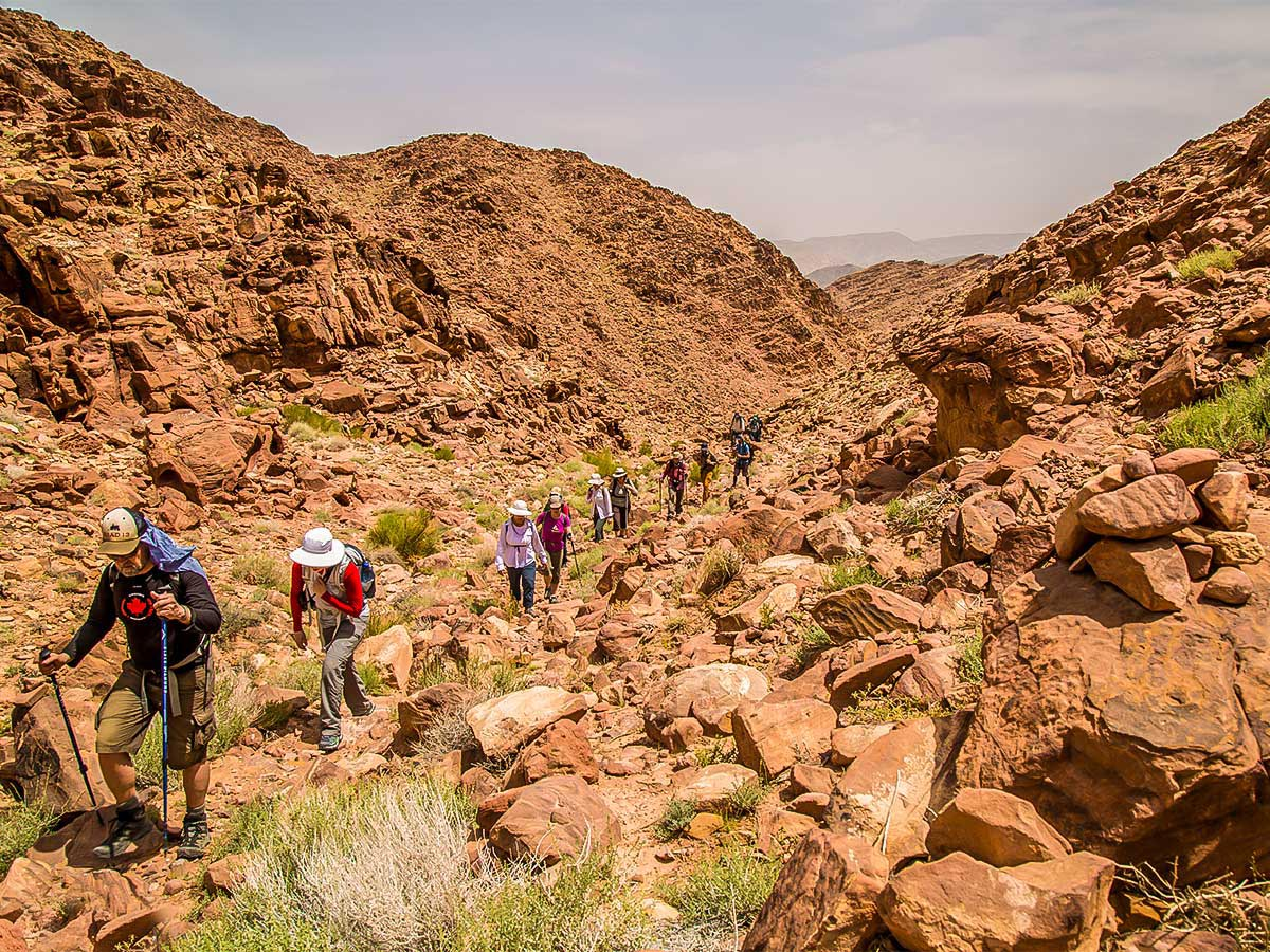 Group with guide on Dana to Petra Trekking Tour in Jordan
