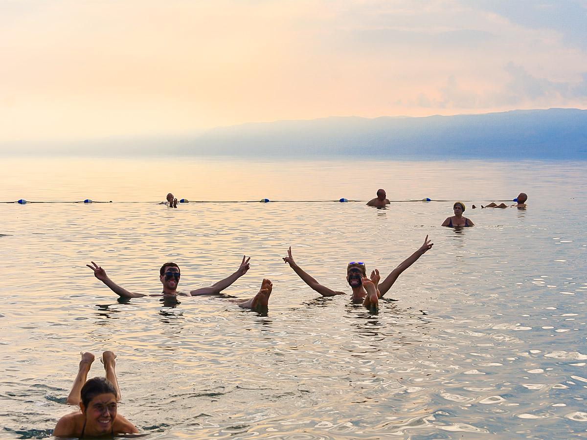 Swimming in Dead Sea on Dana to Petra Trekking Tour in Jordan