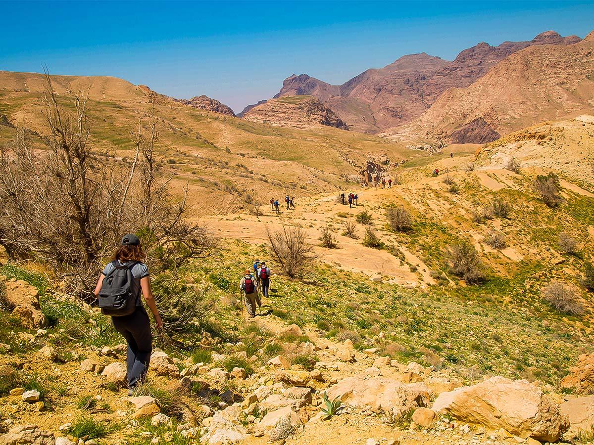 Group of hikers and beautiful views on Dana to Petra Trekking Tour in Jordan