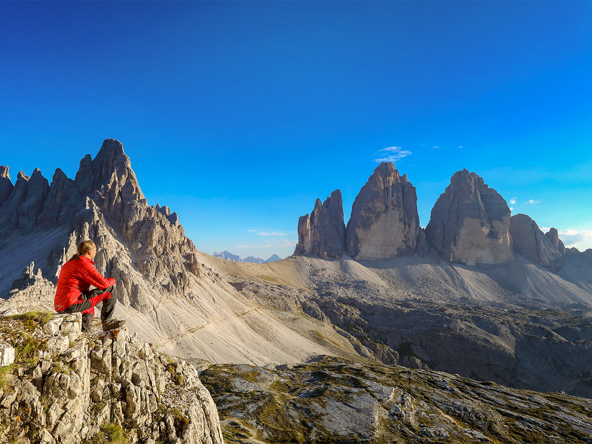 Hiker enjoying the views on Dolomites Haute Route Trek in Italy