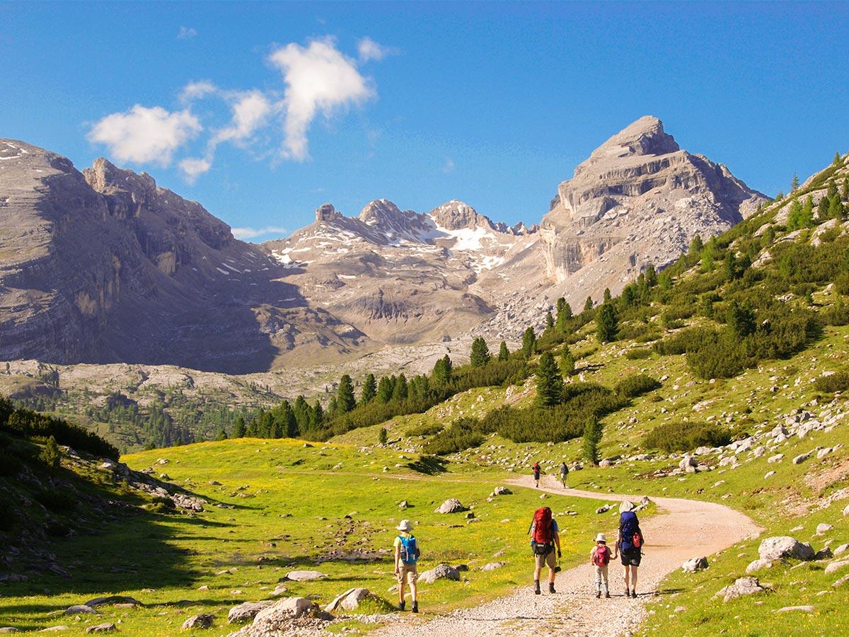 Family hiking on Dolomites Haute Route Trek in Italy