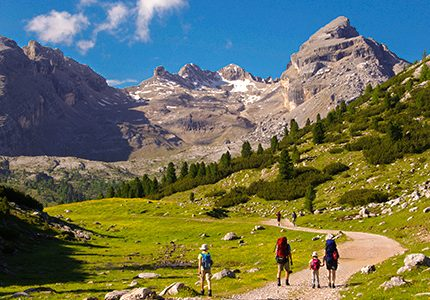 Approaching the mountains on self-guided trekking tour in Dolomites, Italy