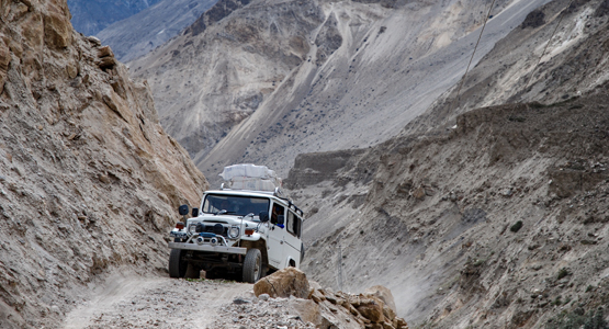 Jeep ride among the mountains on guided trekking tour to K2 Base Camp in Pakistan