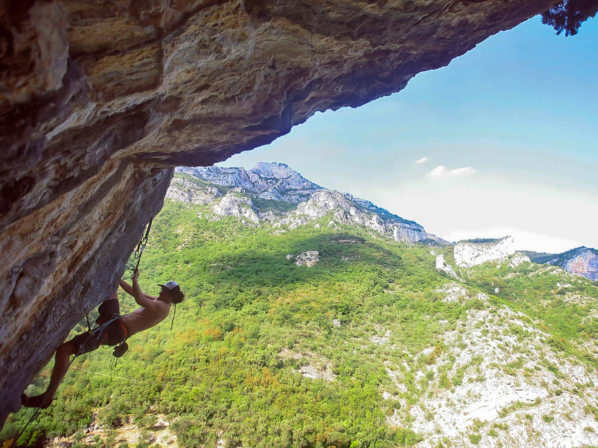 Rock climber and beautiful views on climbing camp in Savona