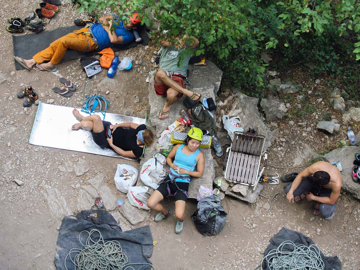 Tired climbers near Finale Ligure on climbing camp in Italian Riviera