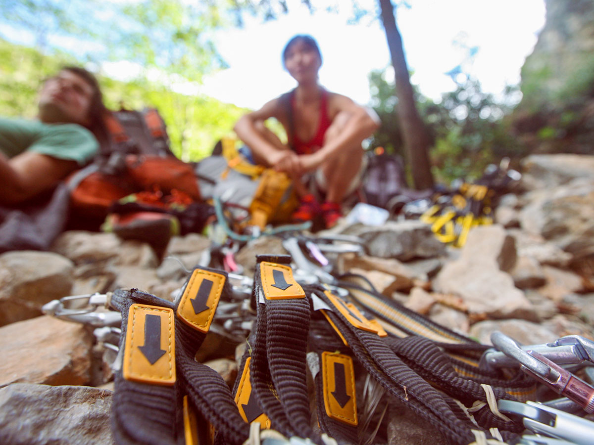Climbers and the gear on rock climbing camp in Italian Riviera
