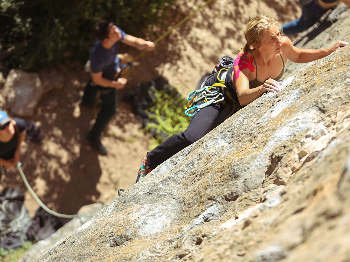 Finding the perfect hold on climbing camp at Gorges du Tarn in France