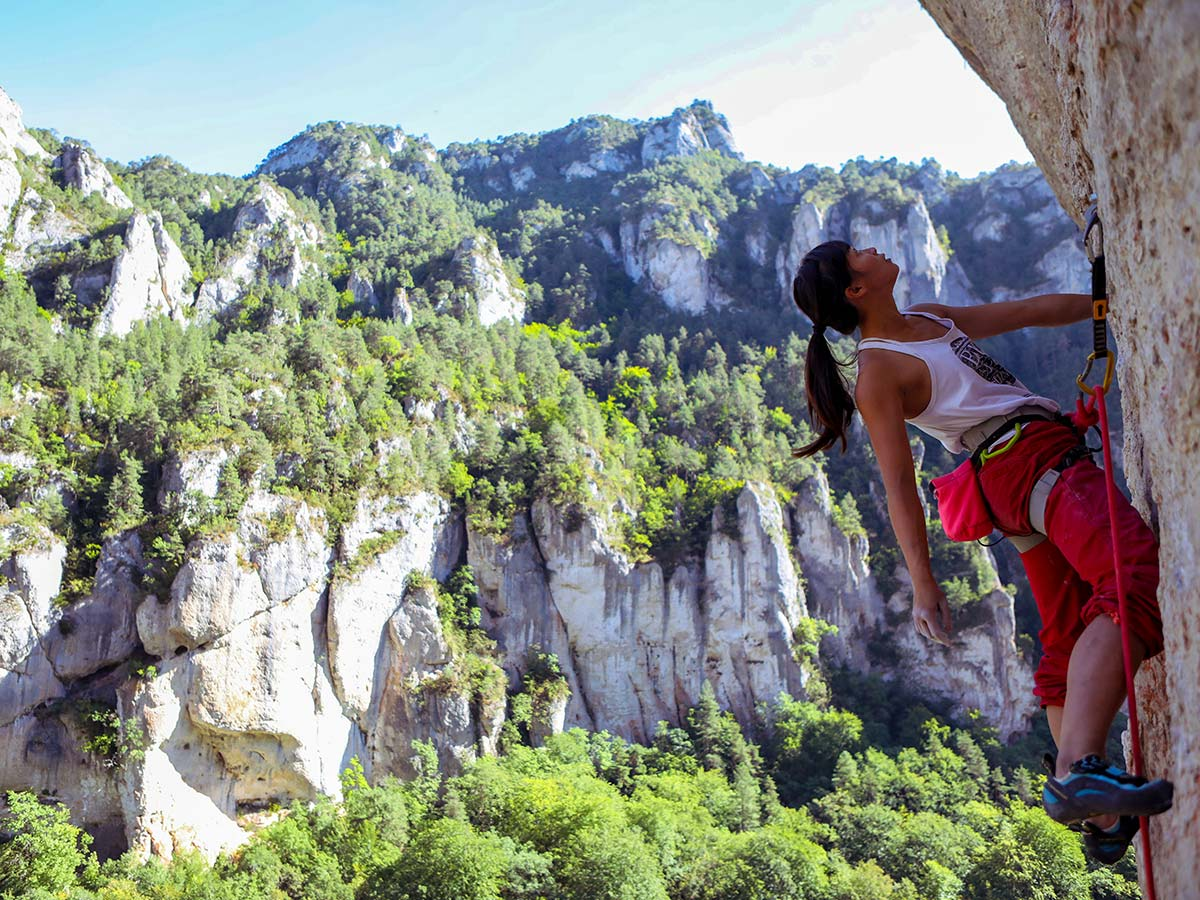 Climbing on rock wall on climbing camp at Gorges du Tarn in France
