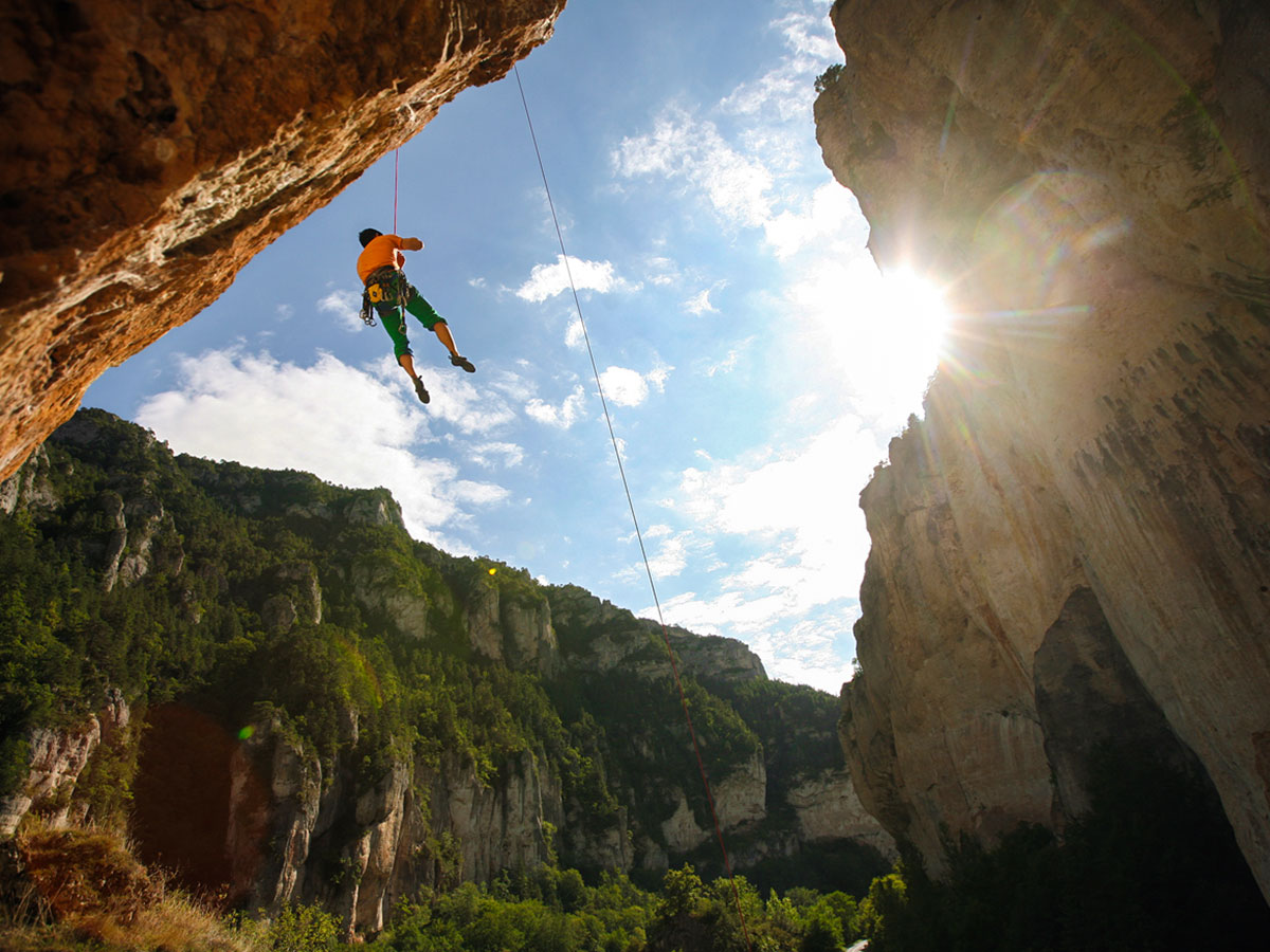 Climbers on rock on climbing camp at Gorges du Tarn in France
