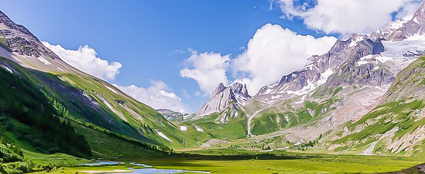 Beautiful valley surrounded by mountains on self-guided Tour du Mont Blanc