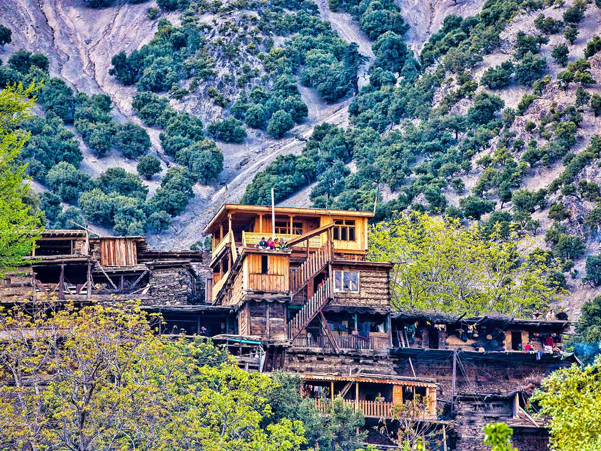 Houses in Kalash Valley on Chitral Valley Overland Tour in Pakistan