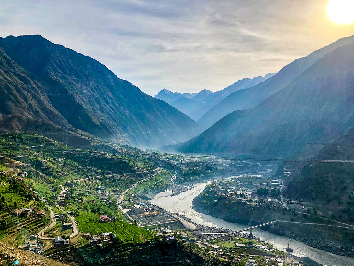 View of the village in the valley from Karakorum Highway on Hanza Valley Overland Tour in Pakistan
