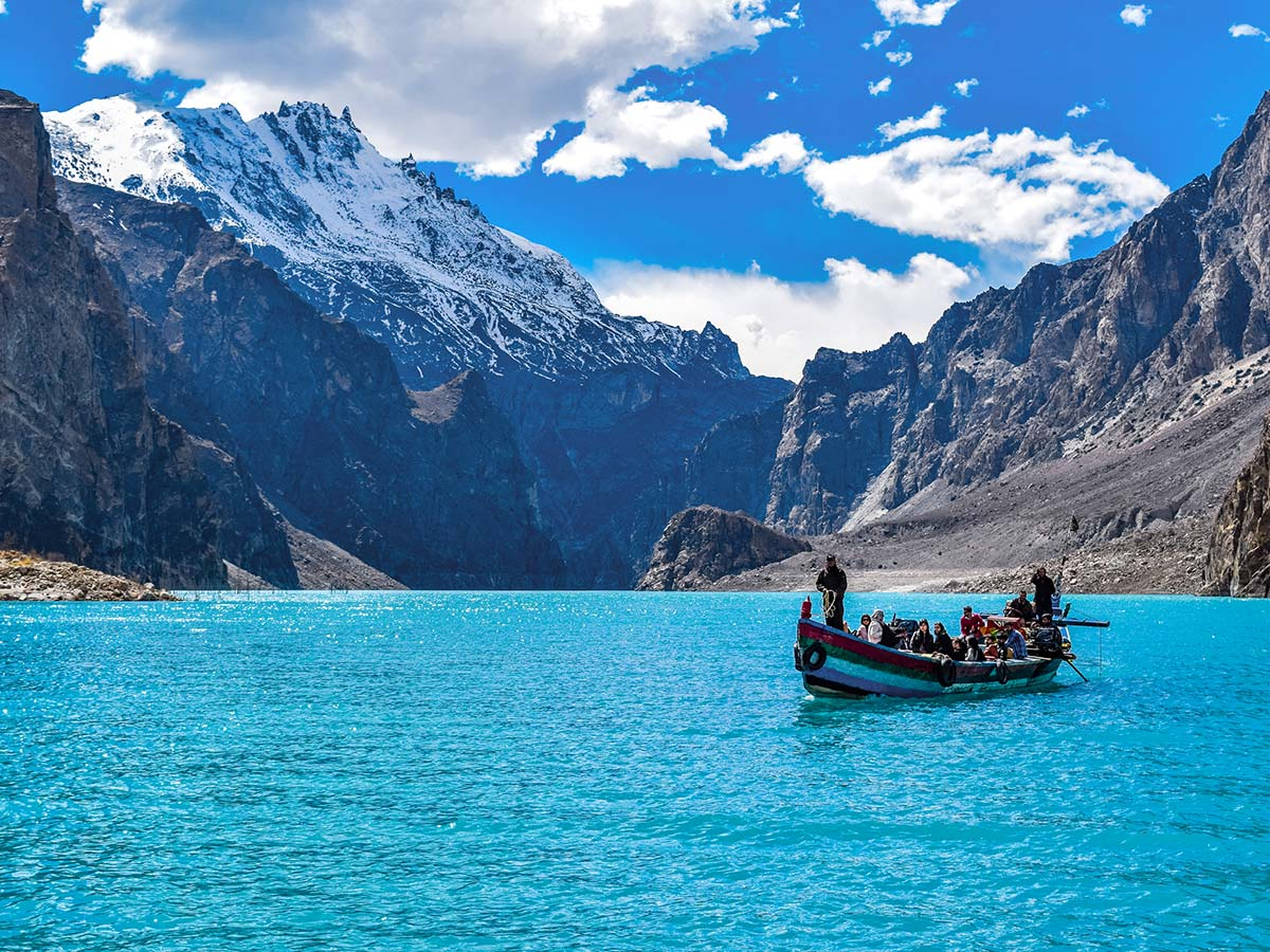 Boat full of people on Attabad Lake on Hanza Valley Overland Tour