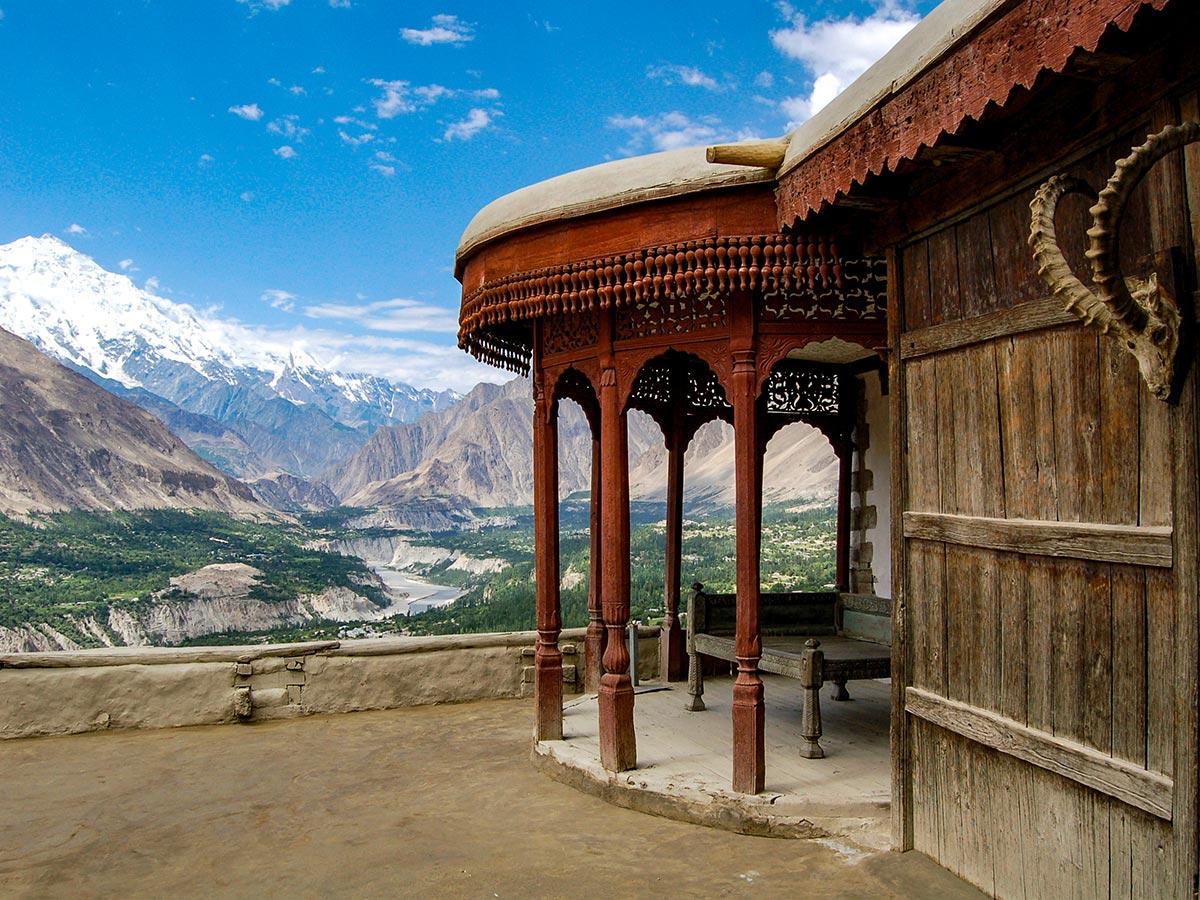 Baltit Fort in front of Rakaposhi Mountains on Hanza Valley Overland Tour in Pakistan