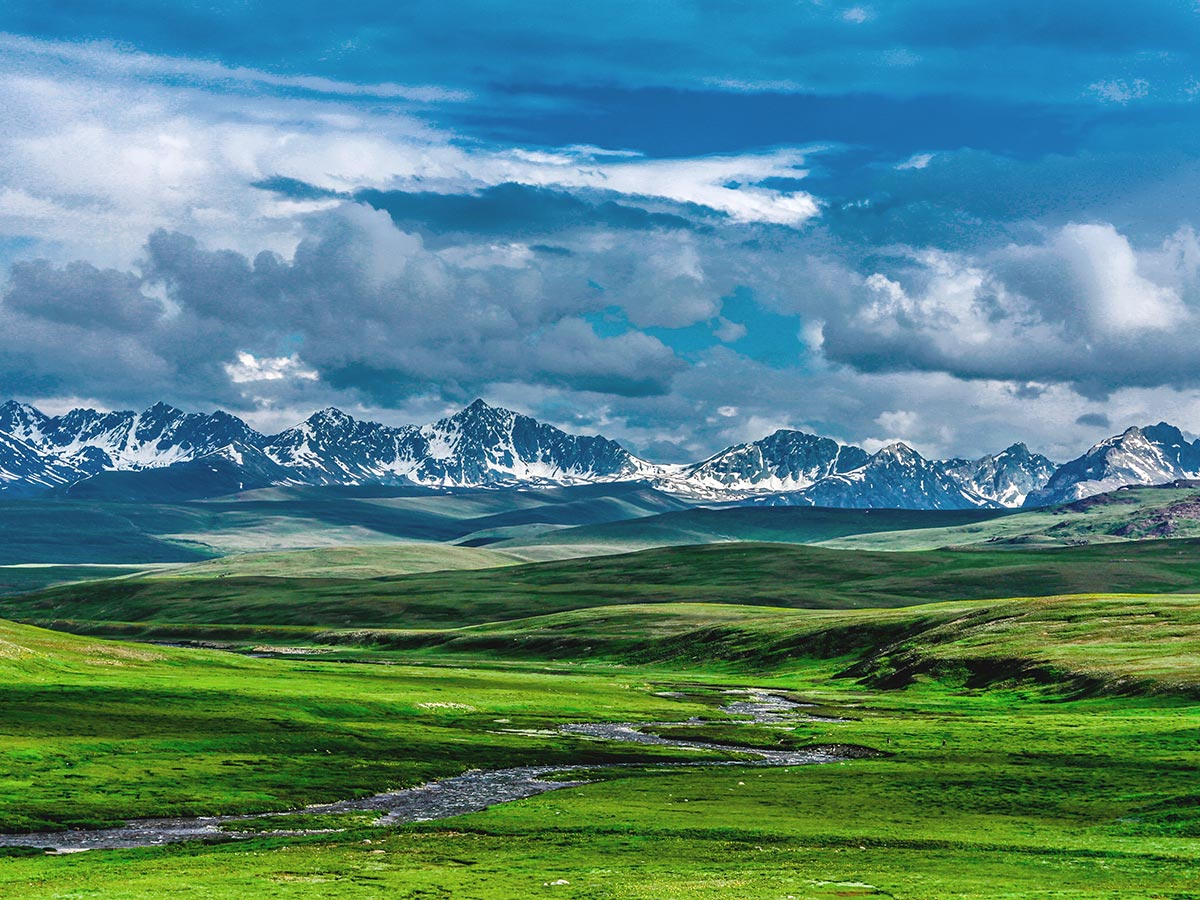 Looking to mountains over Deosai Plains on guided Overland Tour in Skardu Valley Pakistan