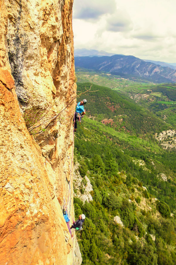 Two men vertical climbing on Trad and Multipitch rock climbing tour in Riglos, Spain