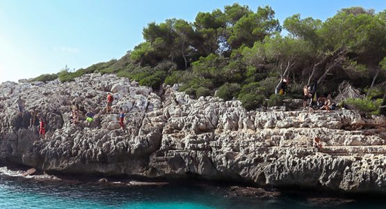 Group of rock climbers above the crag on DWS camp in Mallorca