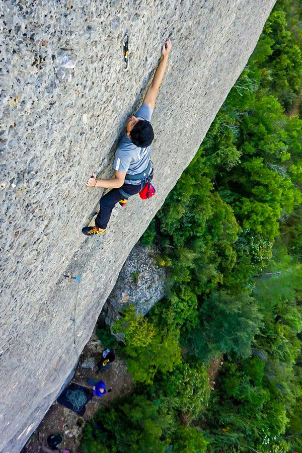 Man climbing in Margalef on guided climbing camp in Spain