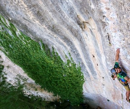 Man climbing on a rock on rock climbing tour in Margalef, Spain