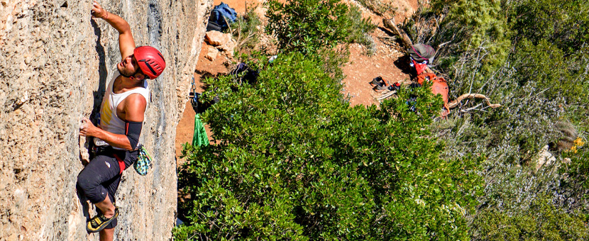 Climber on rock climbing tour in Margalef, Spain