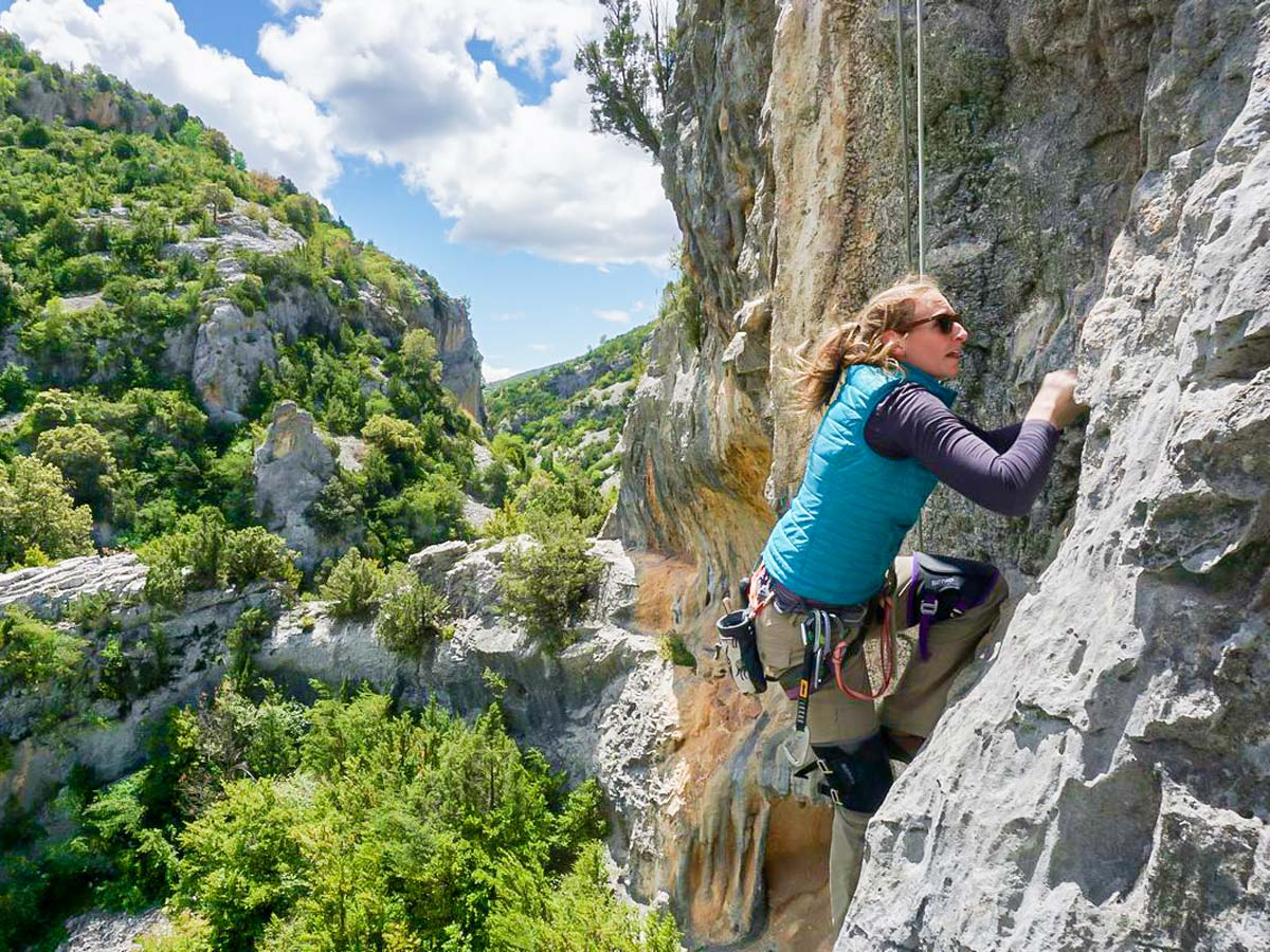 Climber and beautiful views on Women's climbing camp in Rodellar, Spain