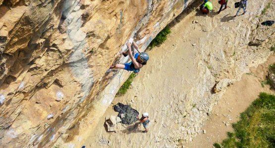 Women climbing on rock in Rodeller