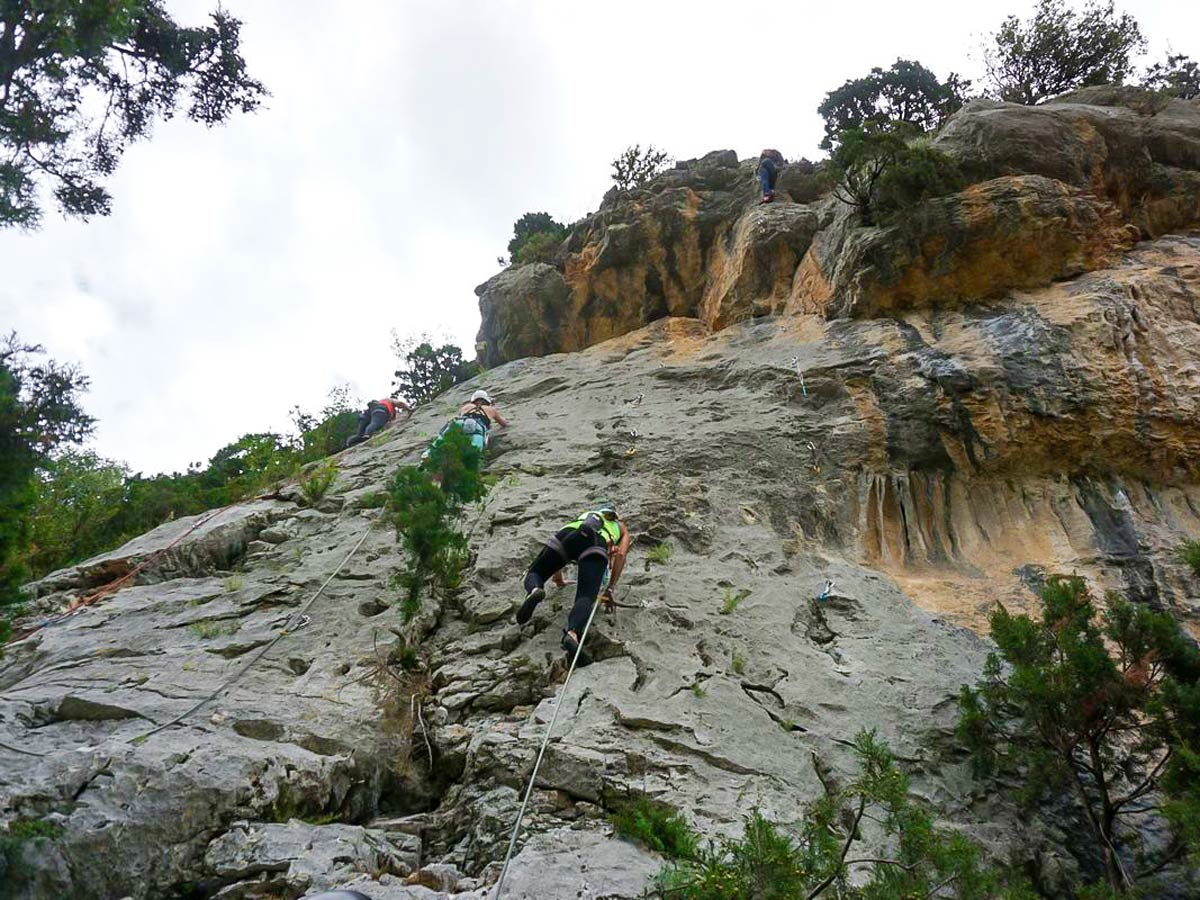 Three rock climbers on Women's climbing camp in Rodellar, Spain