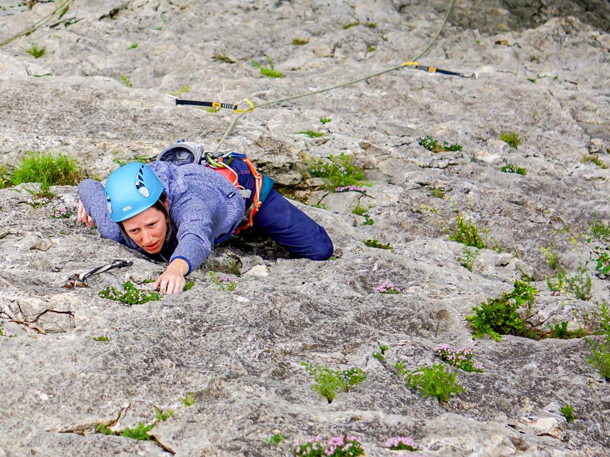 Woman rock climbing on Women's climbing camp in Rodellar, Spain