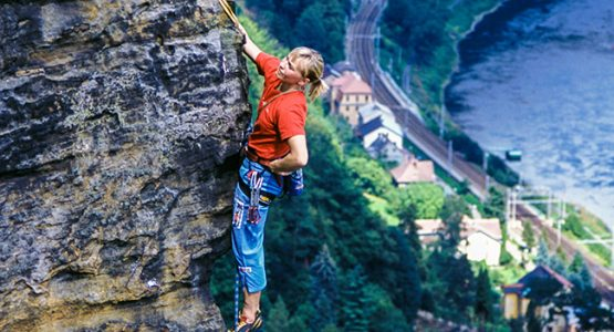 Rock climber and beautiful views on climbing camp in Czech Republic