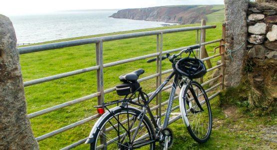 Cornwall Cycling Coast Bike against gate