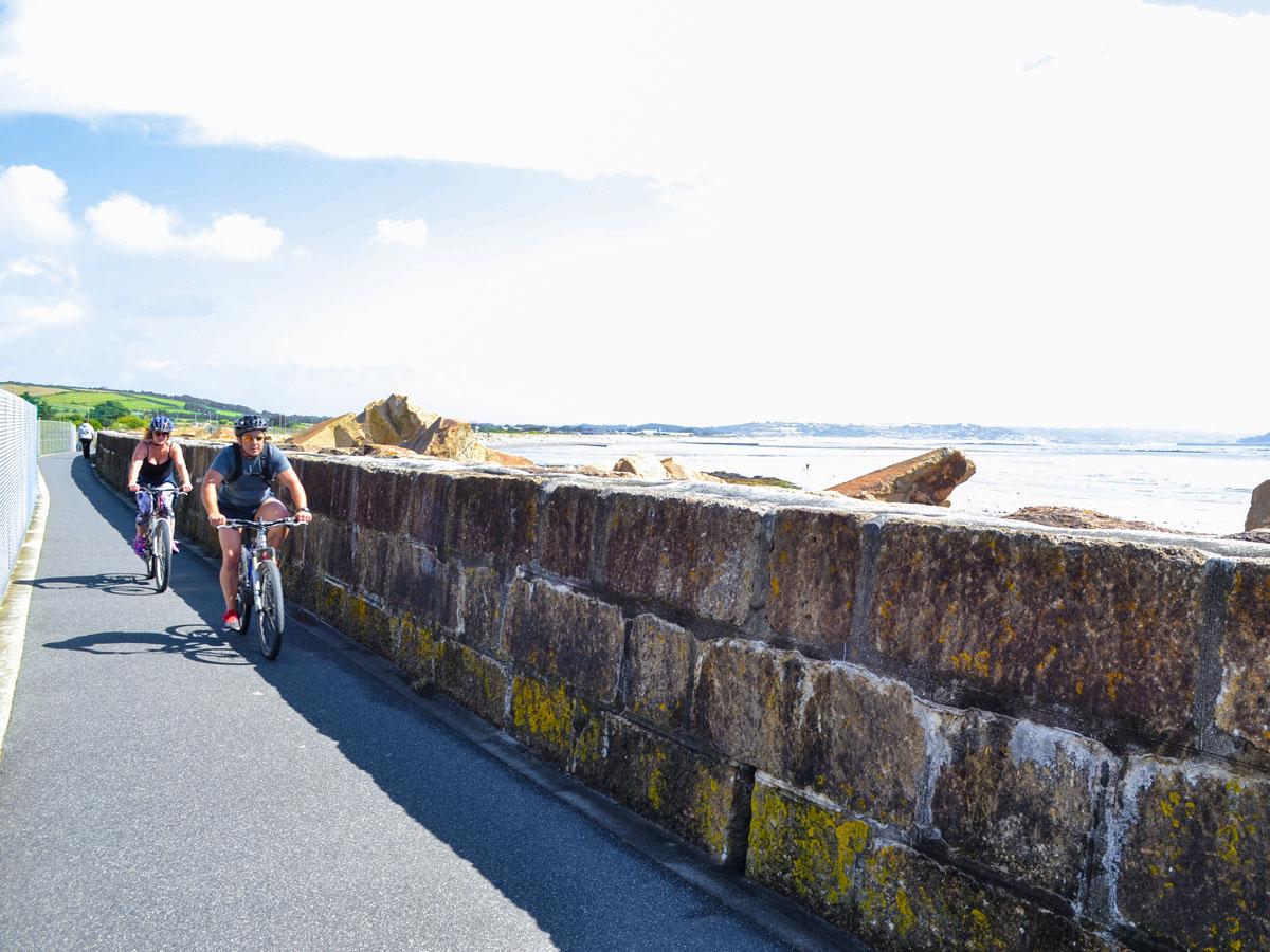 Cornwall cycling along coastal wall